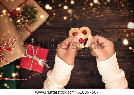Girl with Handmade sweet cookies for Christmas presents and New Year.  #518857507