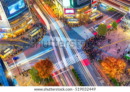Aerial view of Shibuya Crossing, Tokyo. The scramble crosswalk is one of the largest in the world. Long exposition with light trail