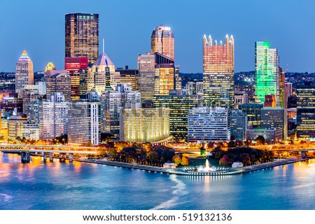 """Pittsburgh downtown skyline at dusk. Located at the confluence of the Allegheny, Monongahela and Ohio rivers, Pittsburgh is also known as """"Steel City"""", for its more than 300 steel-related businesses"""