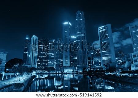 Singapore skyline at night with urban buildings #519141592