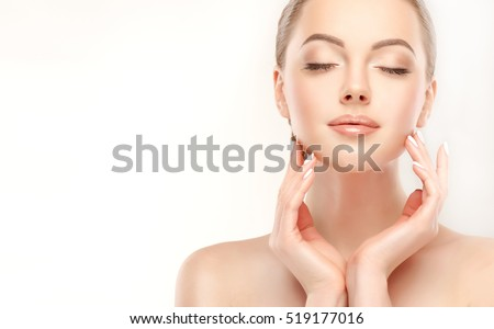 Beautiful Young Woman with Clean Fresh Skin  touch own face . Facial  treatment   . Cosmetology , beauty  and spa . Royalty-Free Stock Photo #519177016