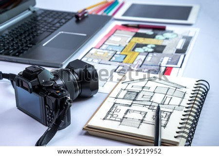 Closeup of camera, laptop, tablet, home illustration & equipments on creative desk / business conceptual