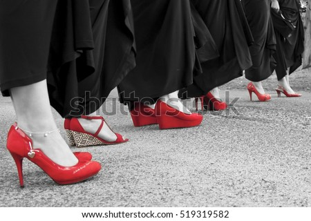 Red shoes with black dresses in black and white photo with color pop