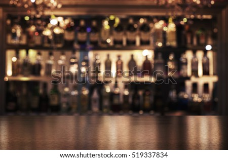 Empty wooden bar counter with defocused background of restaurant, bar or cafeteria and copy space Royalty-Free Stock Photo #519337834