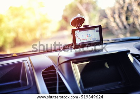 Close-up of gps navigation system In car Royalty-Free Stock Photo #519349624