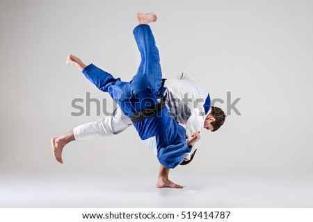 The two judokas fighters fighting men Royalty-Free Stock Photo #519414787