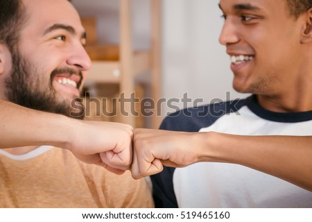 Picture of two best friends men looking at each other, smiling and showing unity between their companies, enterprises or firms. #519465160