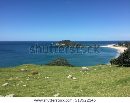 Beautiful turquoise crystal clear blue water in Main Beach and Mount Maunganui #519522145