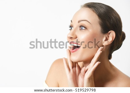 Beauty Fashion Surprised happy young woman looking sideways in excitement. Expressive facial expressions.Emotions. Isolated over white background #519529798