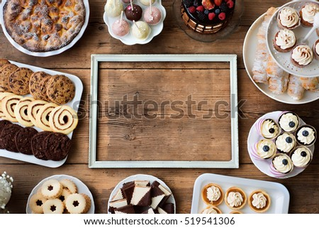 Picture frame and cakes, cookies, cakepops, cupcakes. Copy space