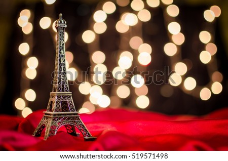 Valentine's Day Wallpaper. Christmas wallpaper. Christmas card. New Year, Christmas, Valentine's Day in Paris. Eiffel Tower on the bright blurred Xmas lights background, space for your text, copyspace