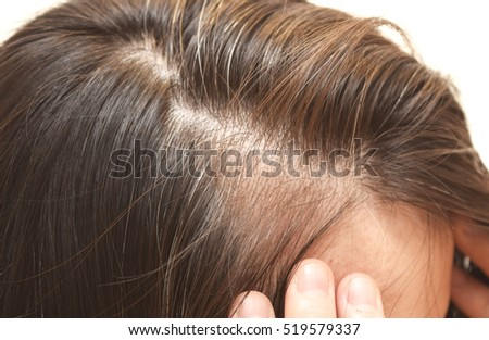 Close up portrait of the hair of a forty years old woman Royalty-Free Stock Photo #519579337