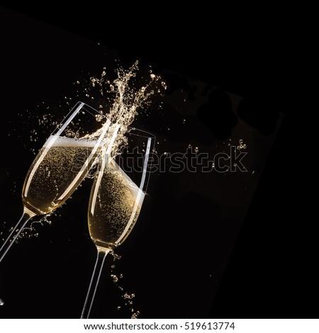 Glasses of champagne with splash, celebration theme. #519613774