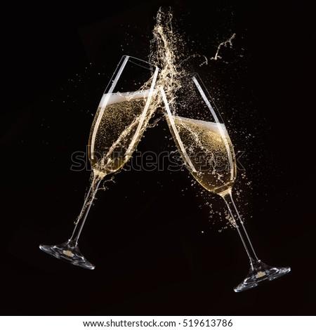 Glasses of champagne with splash, celebration theme. #519613786