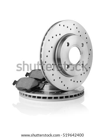 Brake discs and brake pads on white Royalty-Free Stock Photo #519642400