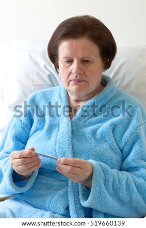 Matured woman with fever #519660139