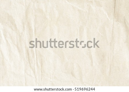 Brown crumpled paper texture #519696244