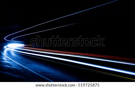 Truck light trails in tunnel. Art image . Long exposure photo taken in a tunnel  #519725875