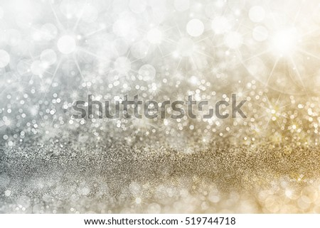 Silver and gold Christmas background with graduated bands of different sparkling and twinkling bokeh from party lights and glitter, full frame copy space