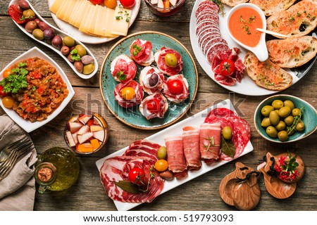 spanish tapas and sangria on wooden table, top view #519793093