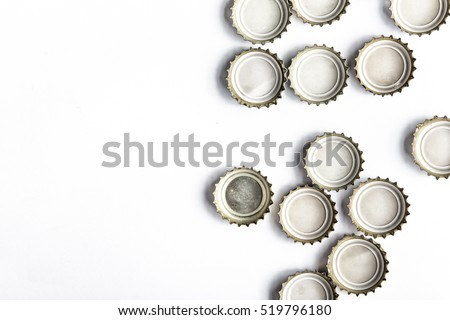 caps of beer on white background, there is a place for an inscription, top view