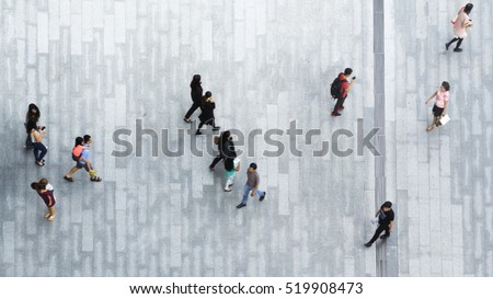 people walk on across the pedestrian concrete landscape in the city street (Aerial top view) #519908473