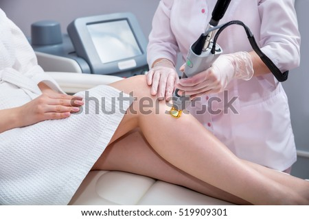 Laser epilation and cosmetology.  Hair removal cosmetology procedure. Laser epilation and cosmetology. Cosmetology and SPA concept.  #519909301