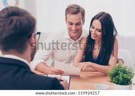 Successful lawyer giving consultation to family couple about buying house #519924217