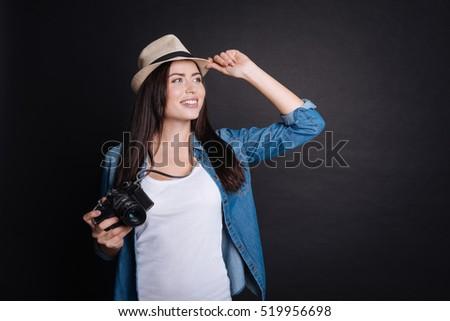 Positive woman holding photo camera. #519956698