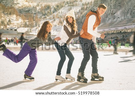 Funny teenagers girls and boy skating outdoor, ice rink #519978508