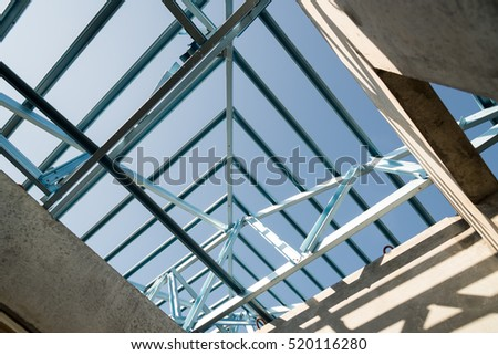 Structure of steel roof frame for building construction on sky background. #520116280