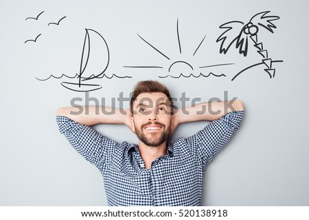Happy young man dreaming about vacation. Drawn picture of seaside overhead.