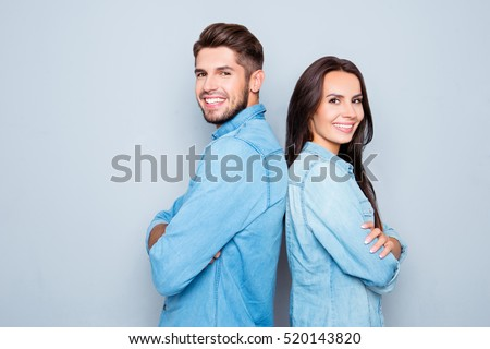 Cheerful hsppy man and woman with crossed hands standing back to back. #520143820