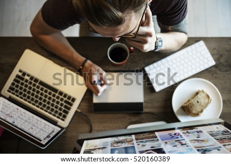 Man Busy Photographer Editing Home Office Concept #520160389