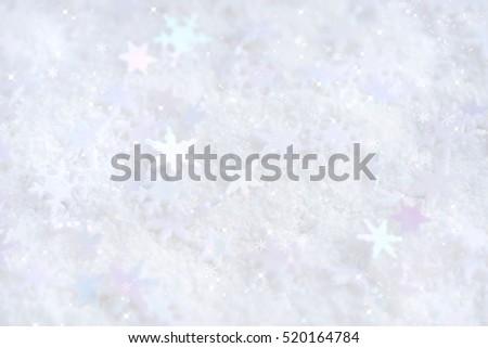 Christmas snowflakes of decoration on snow. Christmas festive background