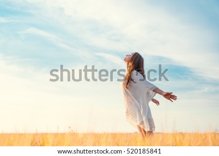 Young girl in a field Royalty-Free Stock Photo #520185841