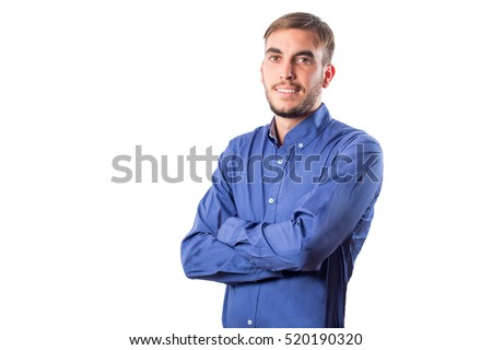 Young boy with blue shirt standing firm and with his arms crossed isolated on white background #520190320