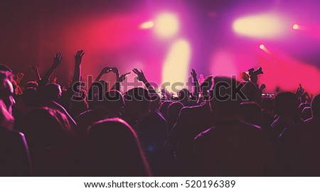silhouettes of a massive crowd at the party concert club music happy #520196389