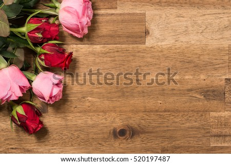 Roses  on wooden background. Valentines day background #520197487
