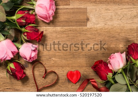 Roses  and red ribbon on wooden background. Valentines day background. Woman's day.Women's day. #520197520