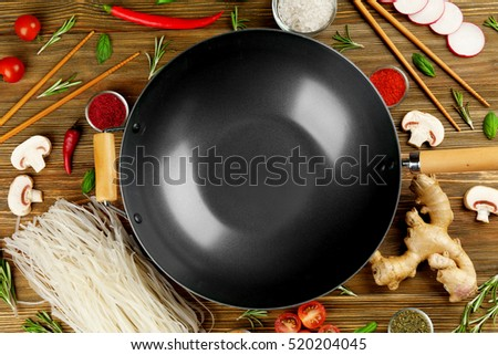 Wok with products on wooden background #520204045