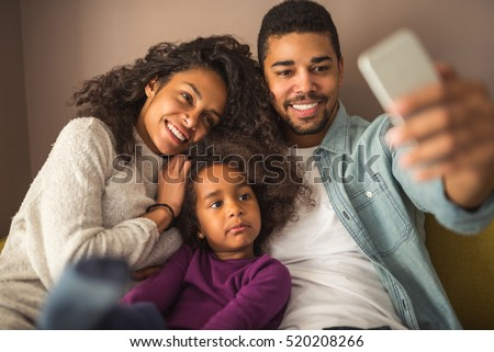 Happy african american family making  a selfie at home. #520208266