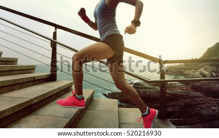 young fitness sports woman  trail runner running on seaside #520216930