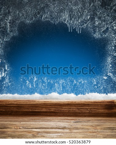 Wooden sill and frozen window. Christmas or New Year background.