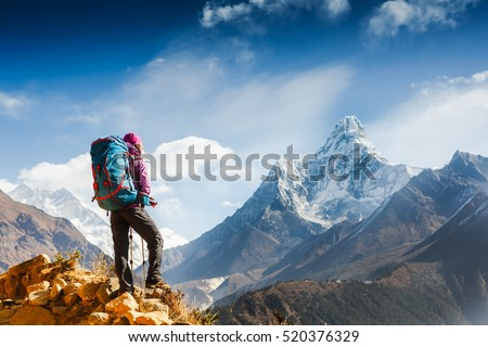 Hiking in Himalaya mountains. Woman Traveler with Backpack hiking in the Mountains. mountaineering sport lifestyle concept Royalty-Free Stock Photo #520376329