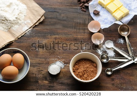 Baking Ingredients for a chocolate cake or brownie on a rustic wooden background  #520420228