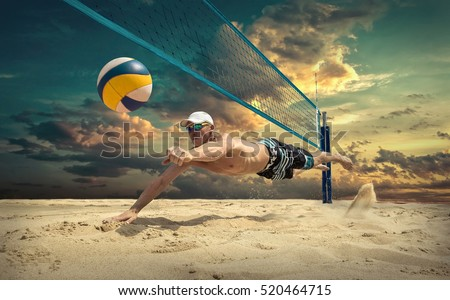 Beach volleyball player in action at sunny day under blue sky. #520464715
