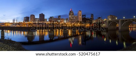 A Wide Panoramic Shot of the Skyscrapers of Downtown St Paul, Minnesota Reflecting Across the Mississippi River during an Autumn Twilight