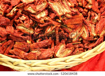 basket of dried tomatoes in the local market in a village in southern Italy #520618438