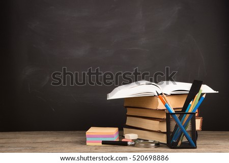 Education concept - books on the desk in the auditorium Royalty-Free Stock Photo #520698886